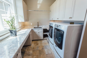 custom Taupe laundry room cabinetry