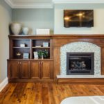 walnut fireplace surround and wallunit with bookcases in master bedroom